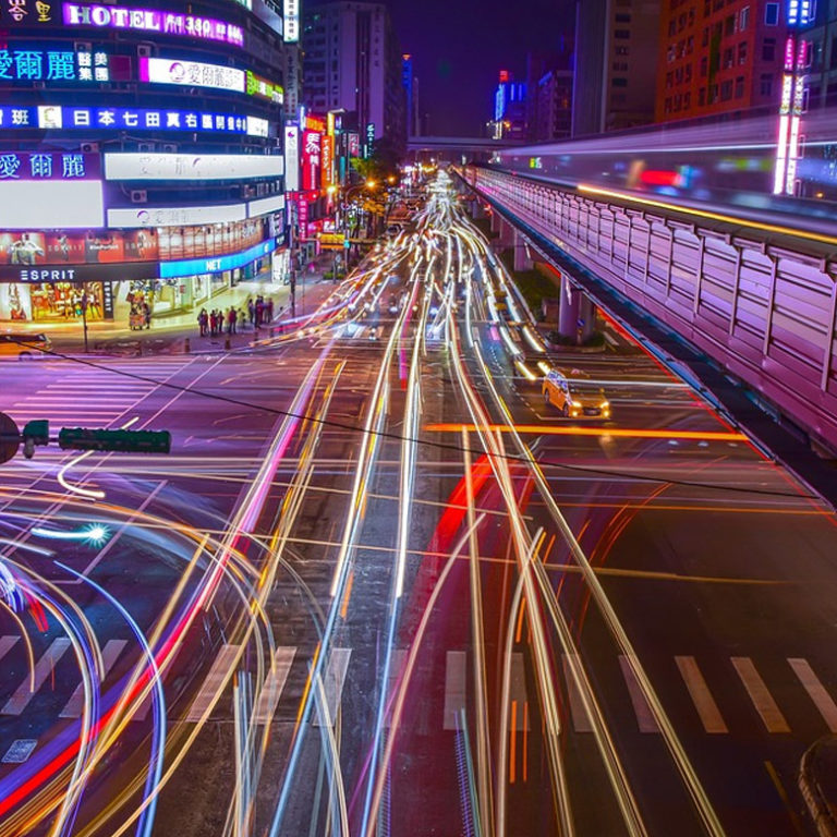 Night life, energy, and color at an intersection in Taipei, Taiwan