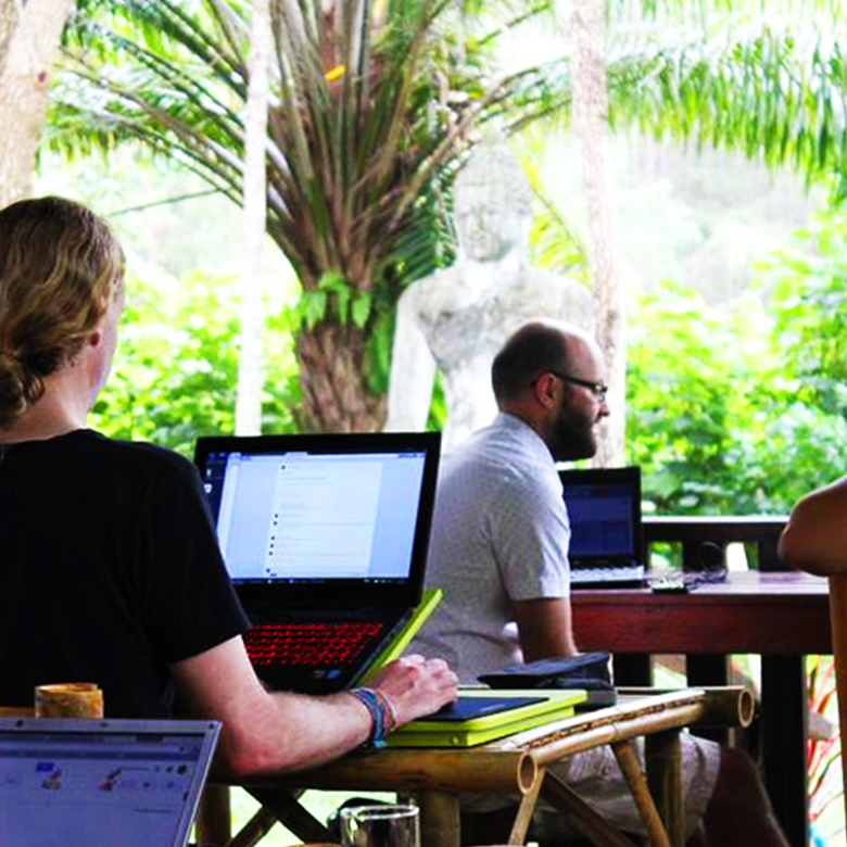 Remote workers work at coworking space in Koh Lanta, Thailand