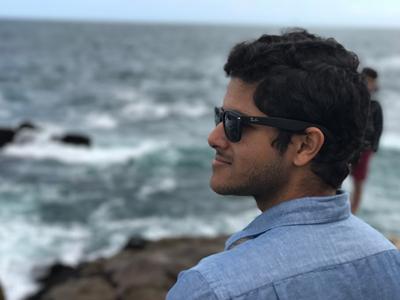 Remote worker entrepreneur looks pensively across the ocean