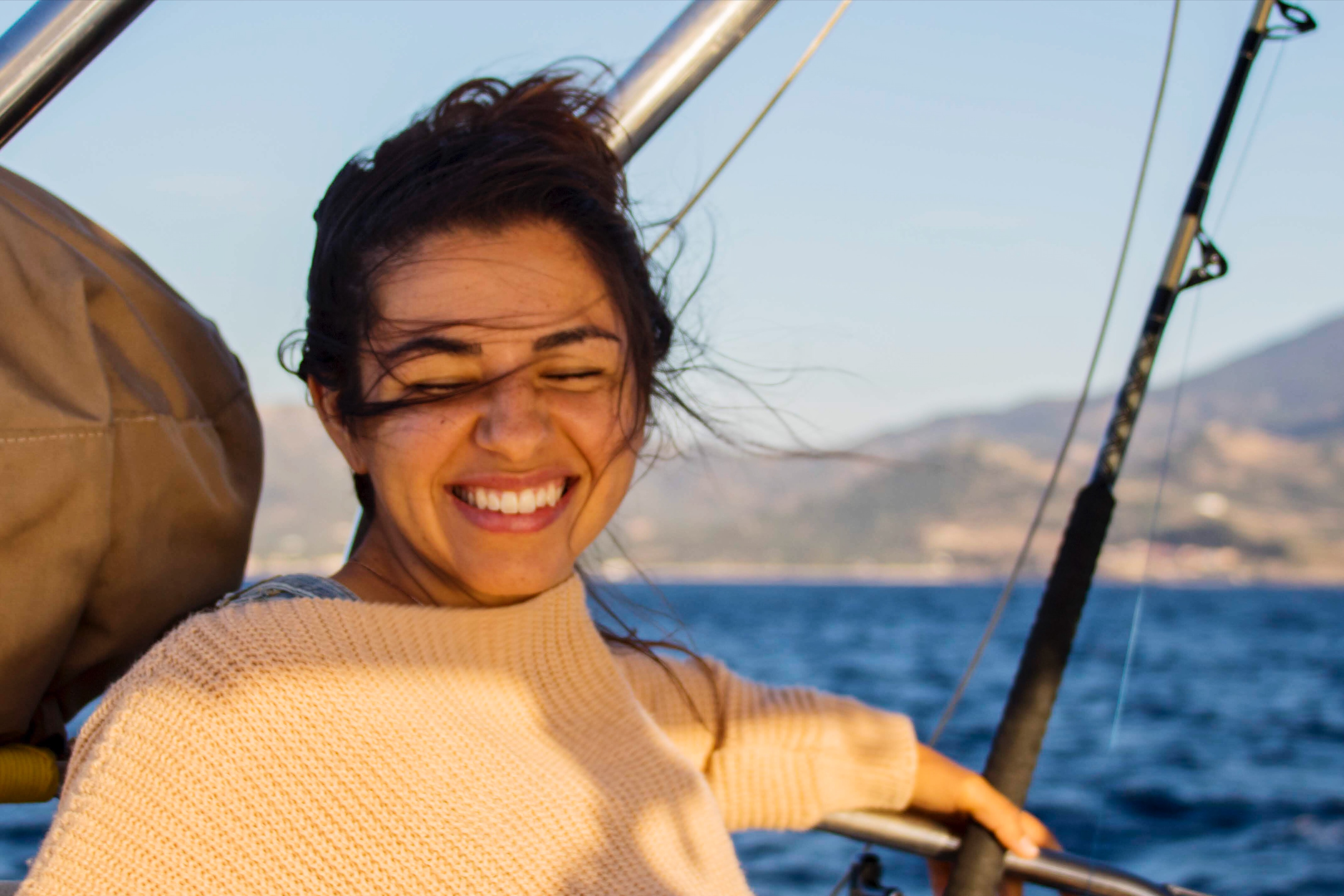 Remote worker on sailboat in Lesbos, Greece on a windy day