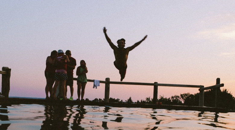 remote-worker-leaps-into-water