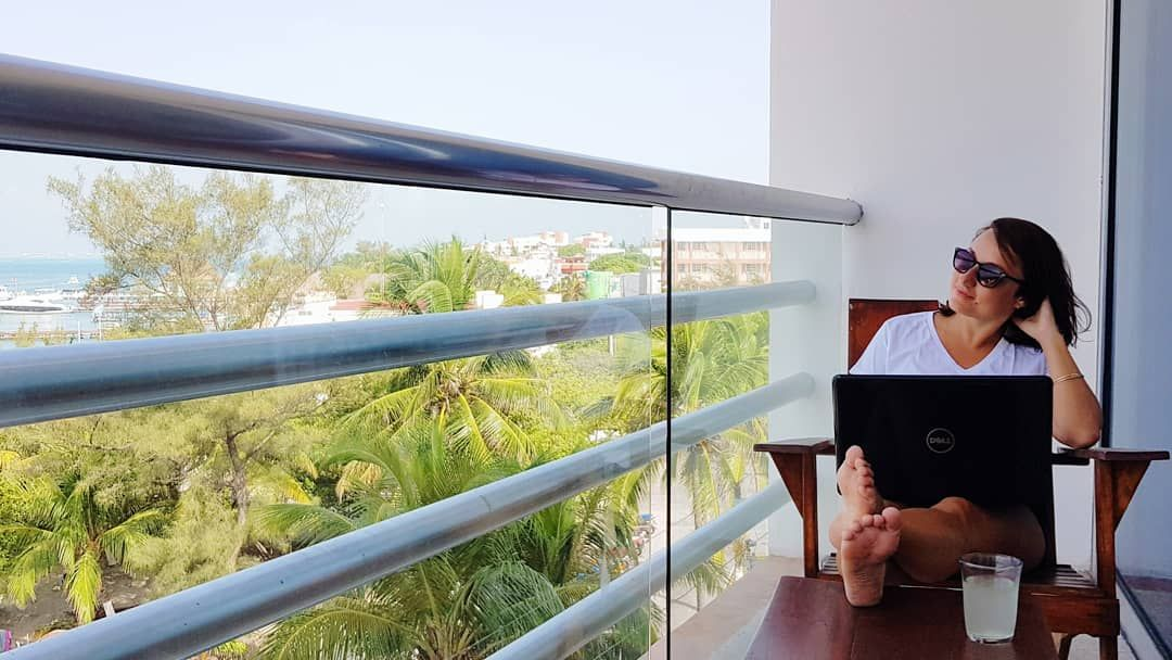 remote-worker-doing-business-from-balcony