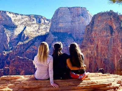 trio-of-remote-workers-overlooking-grand-canyon